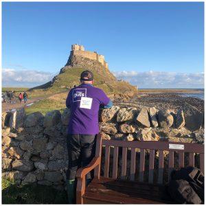 M looking at Lindisfarne